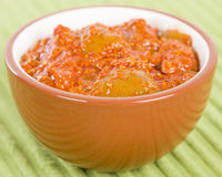Lime Chutney. Indian lime pickle on a green background Stock Image