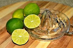 Lime citrus, whole and cut on glass juicer Stock Photography