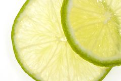 Lime close up. Two limes close up isolated on white Royalty Free Stock Photos