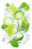 Lime, cucumber, rosemary and mint flying with ices and water splash isolated royalty free stock photo