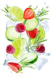 Lime, cucumber, strawberry, raspberry and rosemary flying with i royalty free stock photos