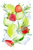 Lime, cucumber, strawberry and rosemary flying with ices and water splash isolated stock photo