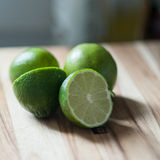Lime, cut lime, citrus fruit. Beautiful fresh cut limes ready for a summer drink or limeade Royalty Free Stock Images