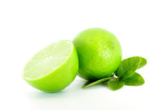 Lime and cut lime with leaves. Isolated on white Stock Photography