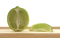 Lime on cutting board Royalty Free Stock Images