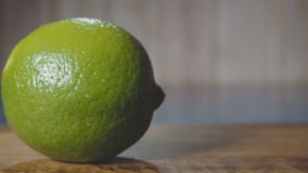 Lime on cutting board stock video
