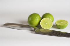 Lime, damask steel knife, white background. Food & Dishes for Restaurants, Cuisine of the peoples of the world, Healthy Recipes Royalty Free Stock Image