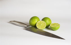 Lime, damask steel knife, white background. Food & Dishes for Restaurants, Cuisine of the peoples of the world, Healthy Recipes Stock Image