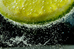 Lime in a drink Royalty Free Stock Images