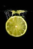 Lime drop into water Royalty Free Stock Photography