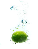 Lime dropped in a water Royalty Free Stock Images