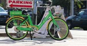Lime-E Electric Bicycle In Orlando Florida USA. Orlando, Florida / USA, March 3, 2019:  Lime-E Green Rental Electric Bicycle Parked On The International Drive In stock footage