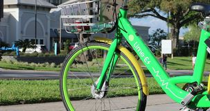 Lime-E Electric Bicycle In Orlando Florida USA. Orlando, Florida / USA, March 3, 2019:  Lime-E Green Rental Electric Bicycle Parked On The International Drive In stock video