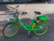 Lime Electric bike parked on a street. Lime Electric bike sharing. Lime Bike is a bicycle-sharing company based in California operating dock-less bicycle-sharing royalty free stock image