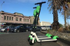 Lime electric scooters in Auckland, New Zealand stock images