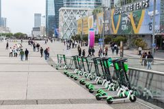 Lime electric scooters are parked at la Défense in Paris, France stock photography
