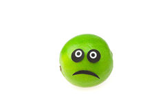 Lime with eyes  and faces isolated on white Stock Photography