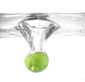 Lime falling into water Stock Image