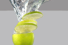 Lime falling into water Stock Photos