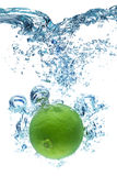 Lime falls deeply under water Royalty Free Stock Photography