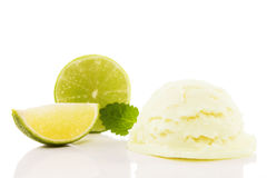 Lime flavored ice cream with a lime slice and a lime blade. And melissa on white background Royalty Free Stock Images
