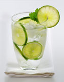 Lime flavored water. Cool lime flavored water with ice cubes Royalty Free Stock Photography