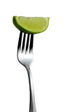 Lime on Fork royalty free stock images