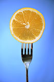 Lime in fork Stock Photo