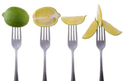 Lime on a fork isolated on white background Stock Image