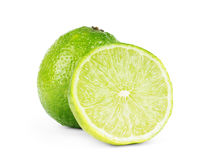Lime. fruit with a half isolated on white Royalty Free Stock Images