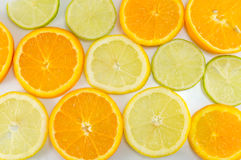 Lime fruit and orange slices making background. Pattern Stock Image