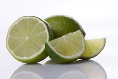 Lime fruit with slices Royalty Free Stock Photography