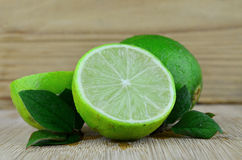 Lime fruits. On a desk background Royalty Free Stock Image