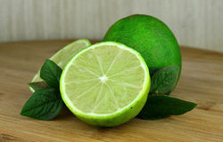 Lime fruits. On a desk background Royalty Free Stock Photos