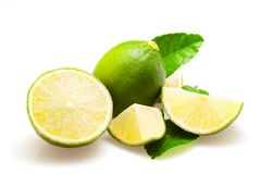 Lime fruits and piece with leaves isolated on white background. Stock Photography