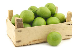Lime fruits in a wooden crate Stock Photography