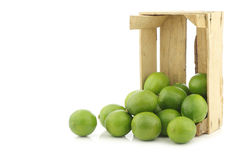 Lime fruits in a wooden crate Stock Photos