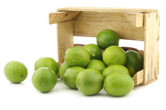 Lime fruits in a wooden crate Royalty Free Stock Photos