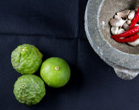 Lime,garlic,chili,kaffir with kitchen tool Royalty Free Stock Images