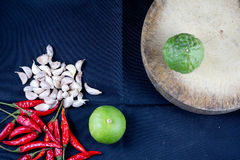 Lime,garlic,chili,kaffir with kitchen tool Stock Images