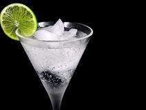Lime Garnish. Slice of lime on cocktail glass royalty free stock photography