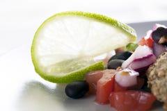 Lime Garnish. On black bean salsa stock images