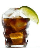 Lime garnish. On a rum and cola drink isolated on a white background stock photos