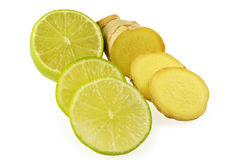 Lime  and ginger cut by segments. On white background Royalty Free Stock Photos