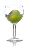 Lime in a glass. On a white background Stock Photos