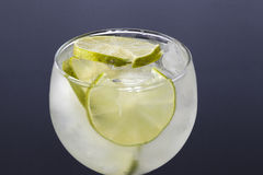 Lime in a glass filled with ice Stock Photo
