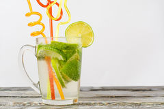 Lime glass and a glass of drink on a wooden table Royalty Free Stock Photography