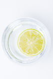Lime in a glass of water  Stock Images