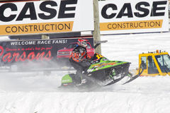 Lime Green Arctic Cat Sno Pro Snowmobile Racing. EAGLE RIVER, WI - MARCH 2:  Lime Green Arctic Cat Sno Pro Snowmobile Racing during a race on March 2, 2013 in Royalty Free Stock Photo