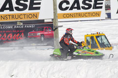 Lime Green Arctic Cat Sno Pro Snowmobile Racing Off. EAGLE RIVER, WI - MARCH 2:  Fast Lime Green Arctic Cat Sno Pro Snowmobile Racing during a race on March 2 Royalty Free Stock Images
